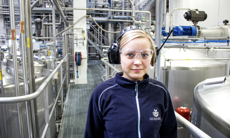 Employee at concentrate factory