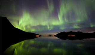 The northern lights play over the night skies over Tromsø in Northern Norway - Photo: Gaute Bruvik - visitnorway.com