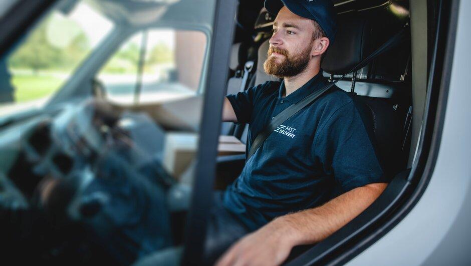 Man driving a van.