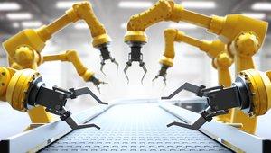 industrial robots working on conveyor belt.