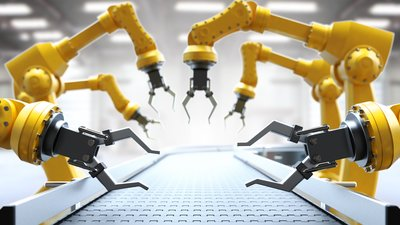 industrial robots working on conveyor belt.