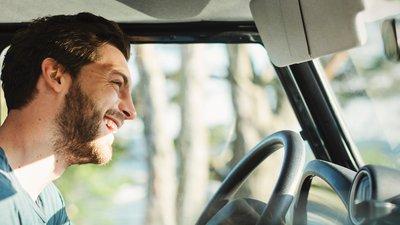 A man drives a car