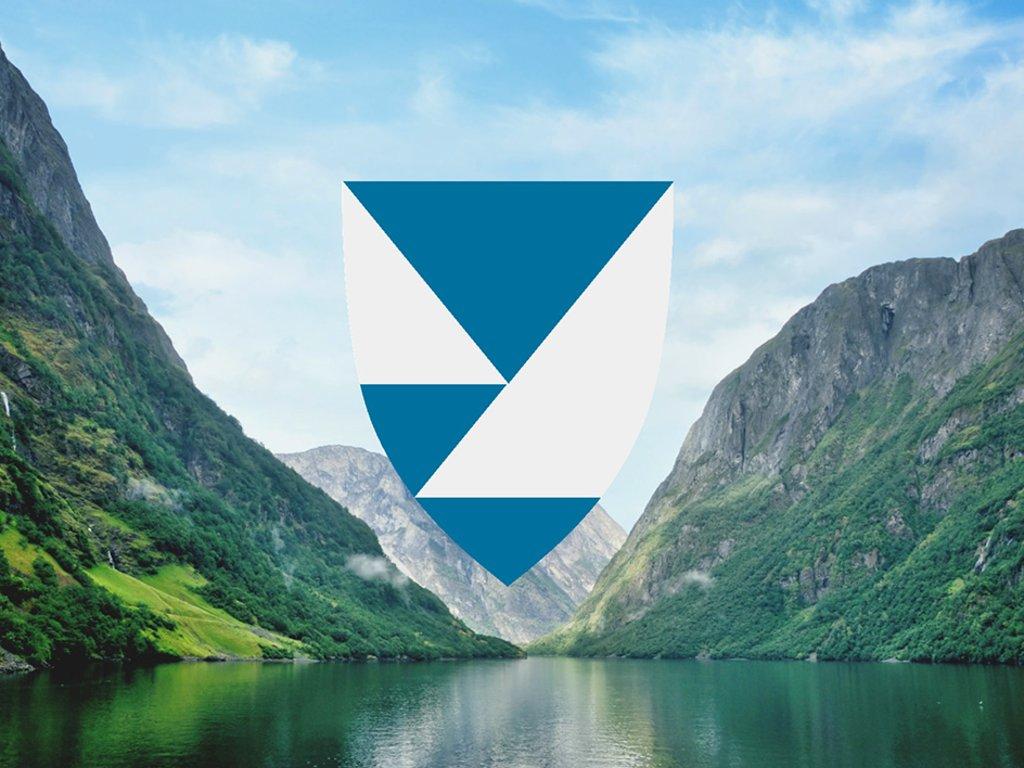 Nytt fylkesvåpen illustrert med fjord og fjell i bakgrunnen