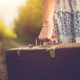 Med resväskan i hand