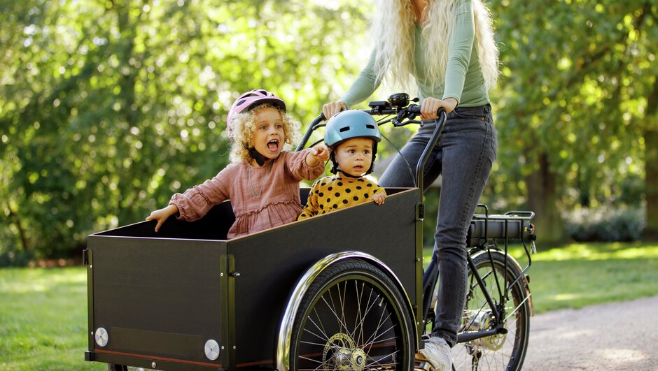 Woman and children riding a cargo bike