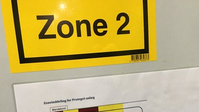 zone classification sign in powder coating area.
