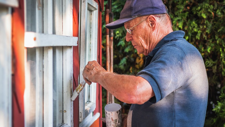 Man painting his cabin.