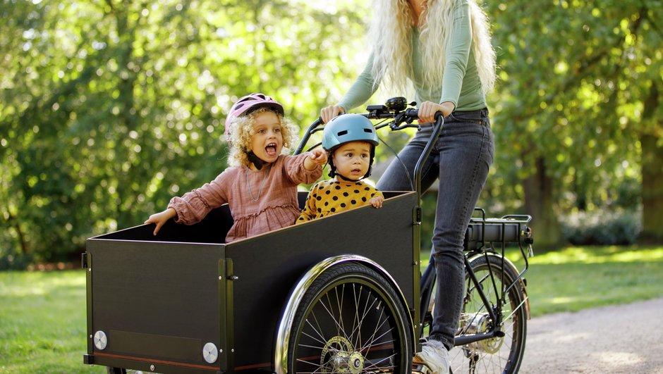 Woman and children on cargo bike