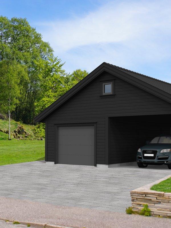 HIBA HUS sort garasje med carport i sommermiljø på oppkjørsel med steinheller