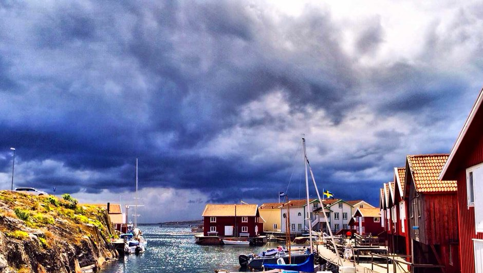 thunder clounds approaching a small harbour