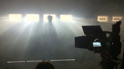 person standing in spotlight