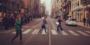 people walkin on zebra crossing